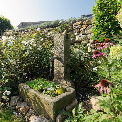 Jardin avec des pavés en pierre naturelle Dortmund : Photos ...