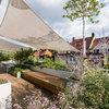 Gartenprofi verwandelt Münchner Dachterrasse zum Blütenmeer