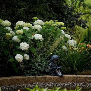 Inspiration for a huge contemporary partial sun backyard stone garden path in Stuttgart for summer.