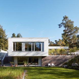 Mittelgroßer Moderner Garten hinter dem Haus mit direkter Sonneneinstrahlung in Sonstige