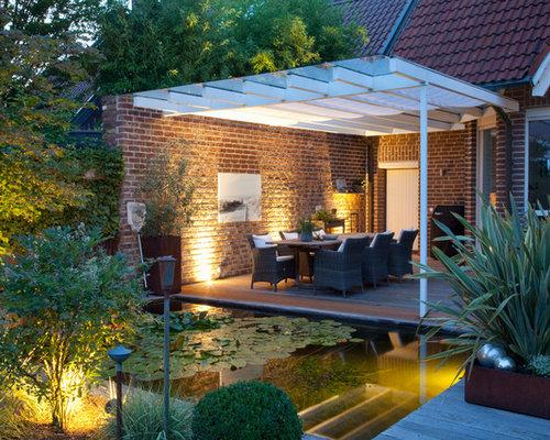Mittelgroßer Moderner Garten Hinter Dem Haus Mit Teich Und Dielen In  Düsseldorf