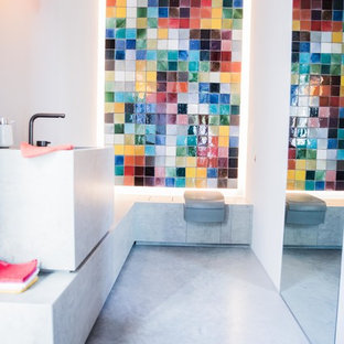 Medium sized contemporary cloakroom in Munich with concrete flooring, multi-coloured tiles, glass tiles, white walls, a pedestal sink, concrete worktops, grey floors and grey worktops.