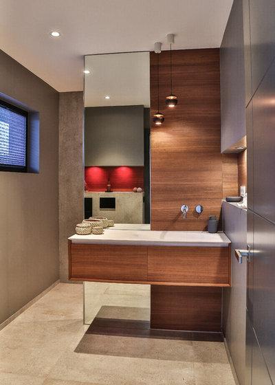 Minimalistisch Gästetoilette by acqua design - exklusive badkonzepte