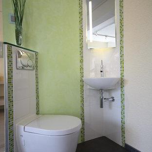 На фото: маленький туалет в современном стиле с раковиной с несколькими смесителями, инсталляцией, белой плиткой, зеленой плиткой, плиткой мозаикой, зелеными стенами и полом из керамогранита с
