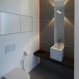 Design ideas for a contemporary cloakroom in Other with a wall mounted toilet, grey tiles, white walls, slate flooring and a vessel sink.