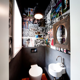 На фото: туалеты среднего размера в стиле фьюжн с серыми стенами, подвесной раковиной и унитазом-моноблоком