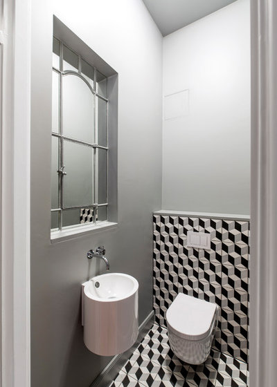 Modern Gästetoilette by iD Architektur