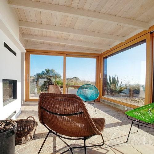 Foto e idee per verande veranda in campagna con camino for Proiettato in veranda con camino