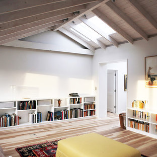 Design ideas for a medium sized scandi enclosed family and games room in London with white walls and light hardwood flooring.