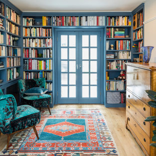 Photo of a bohemian games room in London with a reading nook, beige walls, light hardwood flooring and beige floors.