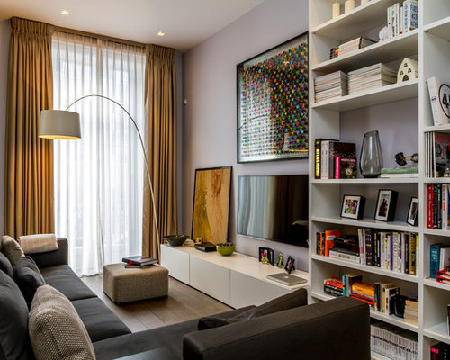 Example Of A Minimalist Enclosed Light Wood Floor Living Room Design In  London With Purple Walls Part 44