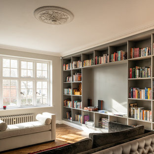 This is an example of a classic games room in London with grey walls, medium hardwood flooring and brown floors.