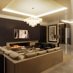 This is an example of a contemporary family and games room in West Midlands.