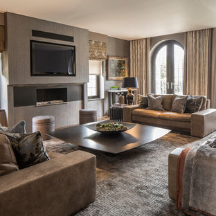 Design ideas for a classic family and games room in London with grey walls, a ribbon fireplace and a wall mounted tv.
