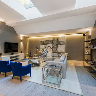 Family room - contemporary open concept family room idea in London with gray walls, no fireplace and a wall-mounted tv