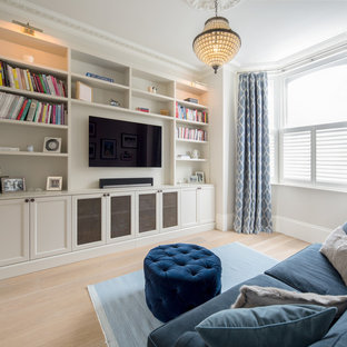Design ideas for a medium sized traditional games room in London with a wall mounted tv, a reading nook, grey walls, light hardwood flooring, no fireplace and beige floors.