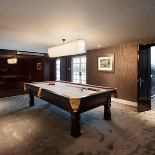 Design ideas for a contemporary family and games room in London with a game room, brown walls, carpet and no fireplace.