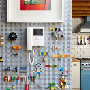 Inspiration for a small eclectic family and games room in London.