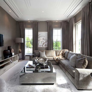 Example of a trendy family room design in Surrey with a wall-mounted tv and brown walls
