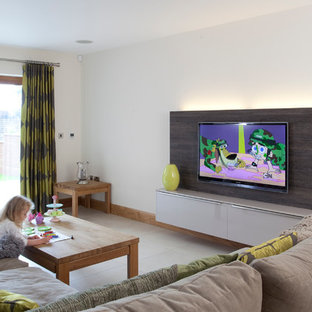 Design ideas for a mid-sized contemporary family room in Belfast with white walls, no fireplace and a wall-mounted tv.