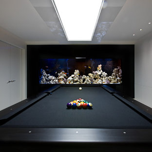 Inspiration for a contemporary family and games room in London with a game room and multi-coloured walls.