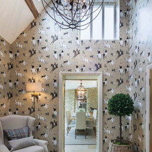 Inspiration for a medium sized country enclosed games room in Gloucestershire with limestone flooring, multi-coloured walls, no tv, beige floors and exposed beams.