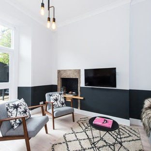 Design ideas for a scandinavian family and games room in Edinburgh with multi-coloured walls, light hardwood flooring and a wall mounted tv.