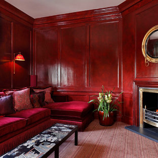 Example of a mid-sized classic enclosed carpeted and red floor family room design in London with red walls, a corner fireplace and a metal fireplace