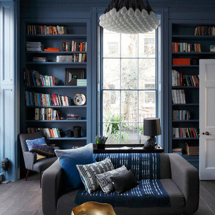 Inspiration for a bohemian enclosed games room in London with a reading nook, blue walls, dark hardwood flooring and grey floors.