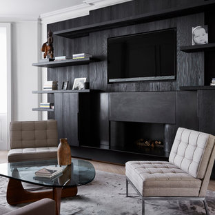 Design ideas for a contemporary games room in London with a ribbon fireplace and a wall mounted tv.