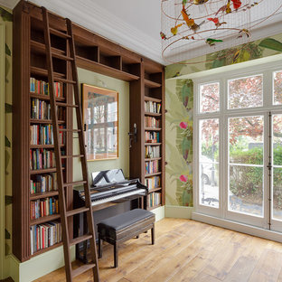 Inspiration for a rural family and games room in London with a music area, green walls, medium hardwood flooring and beige floors.