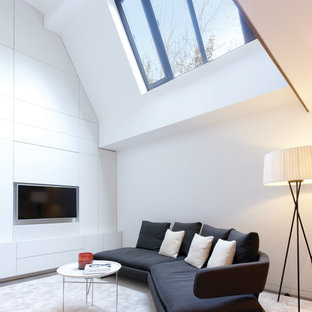 Design ideas for a contemporary family and games room in Other with white walls and a wall mounted tv.