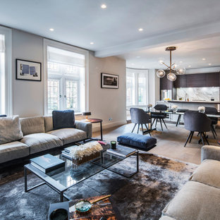Inspiration for a classic open plan family and games room in London with white walls and light hardwood flooring.