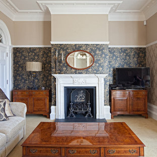 Design ideas for a medium sized traditional enclosed family and games room in Cambridgeshire with beige walls, carpet, a standard fireplace, a stone fireplace surround, a freestanding tv and beige floors.