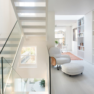 Design ideas for a contemporary mezzanine family and games room in London with a reading nook, white walls, no fireplace and no tv.
