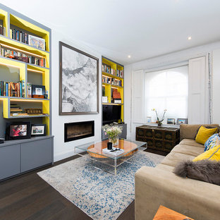 Inspiration for a large contemporary open plan family and games room in London with white walls, dark hardwood flooring, a freestanding tv and brown floors.