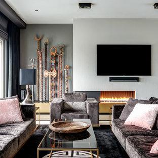 Mittelgroßes, Abgetrenntes Modernes Wohnzimmer mit Teppichboden, Gaskamin, verputzter Kaminumrandung, Wand-TV und schwarzem Boden in Berlin