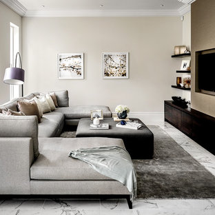Design ideas for a large contemporary enclosed games room in Surrey with a game room, beige walls, marble flooring, no fireplace, a wall mounted tv and white floors.
