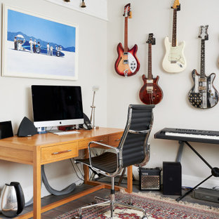Inspiration for a medium sized contemporary games room in Other with a music area, white walls and grey floors.