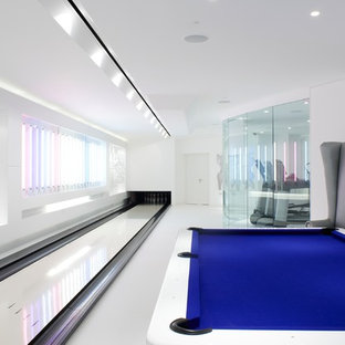 Design ideas for a contemporary enclosed family and games room in London with a game room, white walls and no tv.