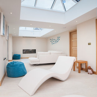 This is an example of a contemporary family and games room in Gloucestershire.