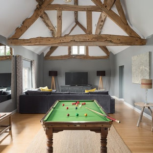 Large rural enclosed family and games room in Cheshire with grey walls, a wall mounted tv and beige floors.