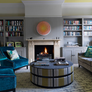 Photo of a medium sized traditional family and games room in Other with grey walls, a standard fireplace and a reading nook.