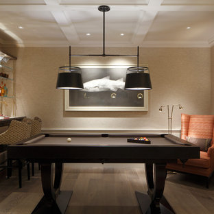 Design ideas for a medium sized contemporary games room in London with a home bar, beige walls, medium hardwood flooring and brown floors.
