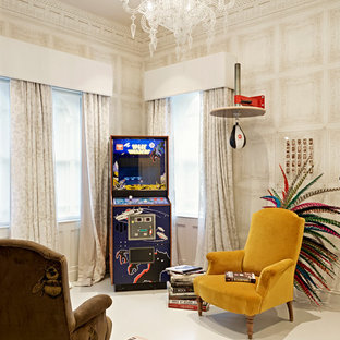This is an example of an eclectic enclosed family and games room in London with a game room, white walls and white floors.