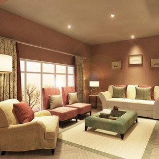 Foto di un piccolo soggiorno minimalista aperto con pareti rosa, pavimento in laminato, camino bifacciale, TV a parete e pavimento grigio