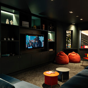 Inspiration for a contemporary enclosed family and games room in Other with green walls, carpet, a wall mounted tv and grey floors.