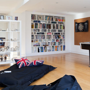 Contemporary family and games room in London with a game room.