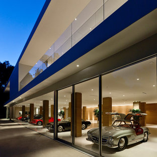 Example of a minimalist attached four-car garage design in Los Angeles