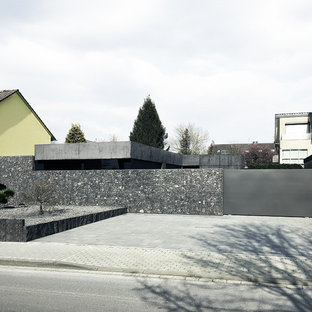 Inspiration for a huge contemporary detached three-car garage remodel in Cologne